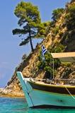Ship anchored near rocky coast of aegean sea in Sithonia Royalty Free Stock Photos