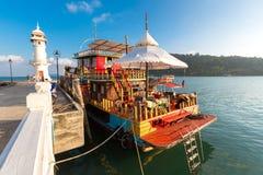 Ship anchored at the pier of Bang Bao village. Koh Chang island Royalty Free Stock Photos