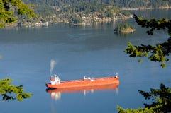 Ship anchoring in a sea inlet Stock Photos