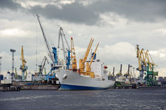 Ship And Cranes Stock Photo