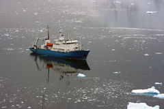 Ship in Antarctic waters Stock Photography