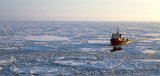 Ship in the Arctic. Evening shot of the ship in the Arctic Sea Royalty Free Stock Photography