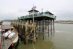 Ship arriving at Victorian pier Stock Image