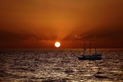 A ship in the background of a beautiful sunset over the Mediterranean Sea. A ship in the background of a beautiful sunset over the Mediterranean Sea in Turkey Royalty Free Stock Photography