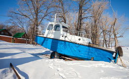 Ship on the bank of river in winter Stock Photo
