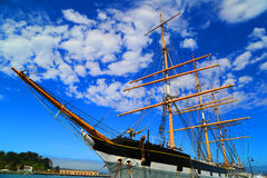 Ship. At the bay with blue skies and clouds Stock Images
