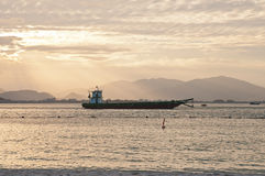 Ship in the bay at sunset in Vietnam Stock Images