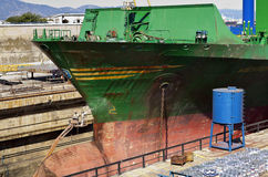 Ship being cleaned in drydock. Ship bow being cleaned in a Gibraltar drydock royalty free stock images
