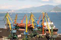 Ship is being loaded with coal in port Nakhodka Stock Image