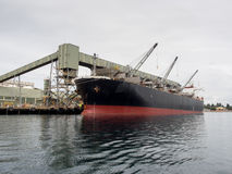 Ship being loaded in port Stock Photos