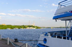 The ship is at berth. Against the river and port Royalty Free Stock Images
