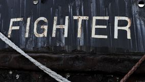 Ship with black hull named fighter stock photography