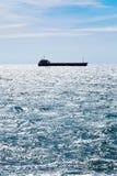 Ship in blue Black sea in autumn Stock Image