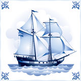 Ship on the Blue Dutch tile 8, Brigantine. Glazed porcelain ceramic, a Sailing vessel with a totality of sails Royalty Free Stock Photos
