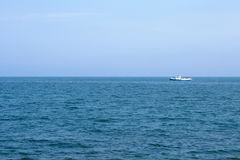 Ship on blue sea horizon Royalty Free Stock Photography