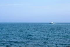 Ship on blue sea horizon. White ship on blue sea horizon, shot in Crimea royalty free stock photography