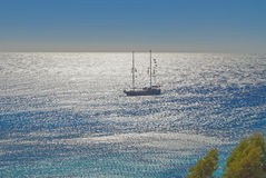 Ship in the blue sea on a sunny day Royalty Free Stock Image