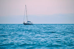 Ship in the blue sea. White ship in the blue sea Stock Photography