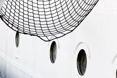 Ship board with portholes and net. Fragment of the sail ship board with net and portholes. Taken on the old German sail ship. Stralsund, Baltic Sea royalty free stock photos