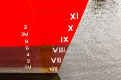 Ship Bow Depth Numbers. Ship boat bow with depth cargo numbers in red paint closeup in hatbor port stock images