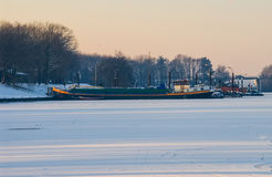 Ship boat caught in frozen sea icebound ice snow harbor sun Royalty Free Stock Photo