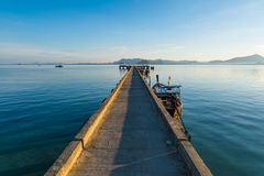 Ship boat dock at calm sea blue water and sky in Thailand Stock Images