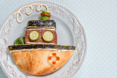 Ship boat pita bread with burger cutlet for kids lunch Royalty Free Stock Photography