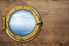 Ship or boat porthole on wooden wall Stock Photos