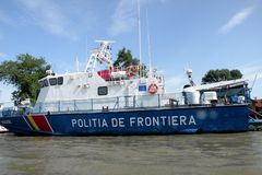 Ship of Border Police on the Danube Delta channel. Royalty Free Stock Photography