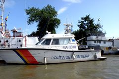Ship of Border Police on the Danube Delta channel. Royalty Free Stock Images
