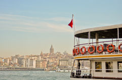 Ship in Bosporus with Galata Tower background Stock Photo