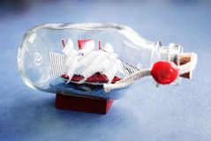 Ship in a bottle. Small decorative ship in a bottle Stock Images