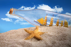 Ship in a bottle in a pile of sand Royalty Free Stock Image