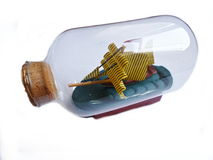 Miniature frigate in the bottle Royalty Free Stock Photo