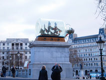 Ship in bottle at Trafalgar Square in front of The National Gallery. London, UK - January 2012 : Tourist taking pictures at Nelson's Ship in a Bottle, by leading Stock Photo