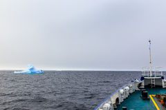Ship bow and Iceberg drifting at Lemaire Channel stock photo