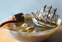 The ship in the bowl with soup royalty free stock photo