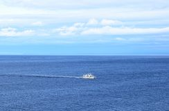 Ship in the calm blue sea Stock Image