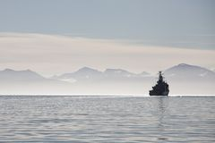 Ship on a calm sea in Svalbard islands, Norway Stock Photos