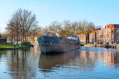 Ship at the canal of Delft, Holland and dutch houses Stock Photography