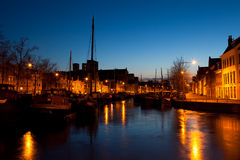 Ship on canal in Dutch city at night Royalty Free Stock Photos