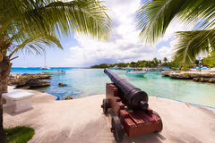 Ship cannon on the embankment of the city of Bayahibe, La Altagracia, Dominican Republic. Copy space for text. Stock Photo