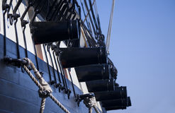 Ship Cannons. Cannons on a tall ship know as a sloop-of-war from the early 19th century stock photography