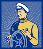 Ship captain at the helm. Imagery shows a ship captain at the helm done done in retro style Stock Images