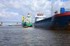 Ship with cargo on the Kiel Canal, Germany Royalty Free Stock Photos