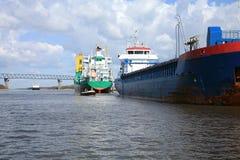 Ship with cargo on the Kiel Canal, Germany Royalty Free Stock Photos