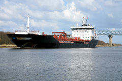 Ship with cargo on the Kiel Canal, Germany. Royalty Free Stock Image