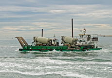 Ship carrying the big concrete mixers Stock Images