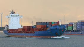 Ship carrying containers through rotterdam stock video footage