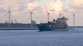 Ship carrying containers through rotterdam stock footage
